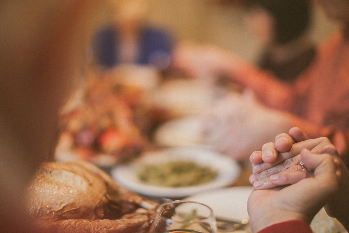 Giving thanks at the dinner table.